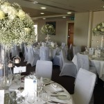 tall centre pieces gyp and white roses