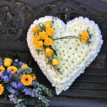 White Based with Yellow Rose Spray Heart Funeral Tribute Flowers